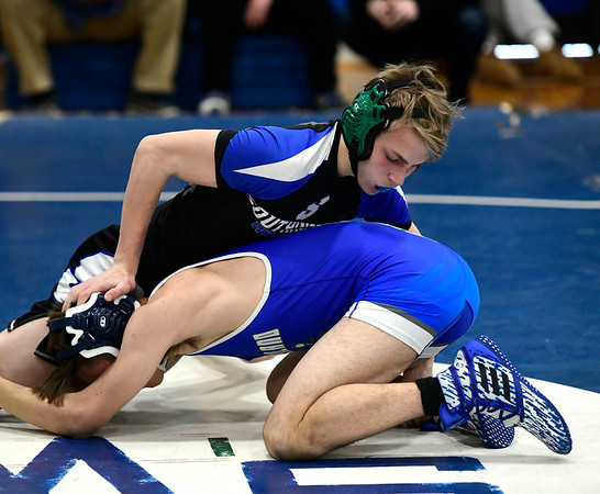 1/26/2019 Mike Orazzi | Staff Cumberland's Quintyn Salisbury and Southington's Jared Guida wrestle at Southington High School Saturday.
