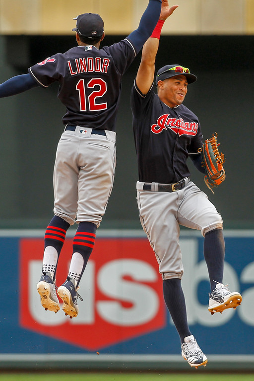 . Cleveland Indians\' Francisco Lindor (12) and Leonys Martin celebrate the 2-0 win against the Minnesota Twins after a baseball game Wednesday, Aug. 1, 2018, in Minneapolis. (AP Photo/Bruce Kluckhohn)