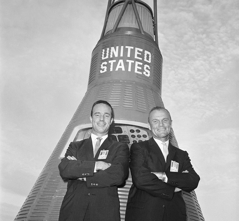 . Astronauts John Glenn, right, and Scott Carpenter pose in front of a Mercury Capsule after Glenn was named to make this countrys first manned orbital flight, Nov. 29, 1961, Cape Canaveral, Fla. Carpenter was chosen as his backup pilot. (AP Photo)