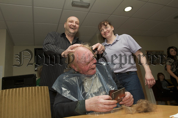 Charity Night in aid of Macmillan Nurses in the Armagh Down Bar on Saturday last. Charlie Dundalk gets a Head Shave from Barry Mc Anulty and Allie Mc Knight.10W45N707