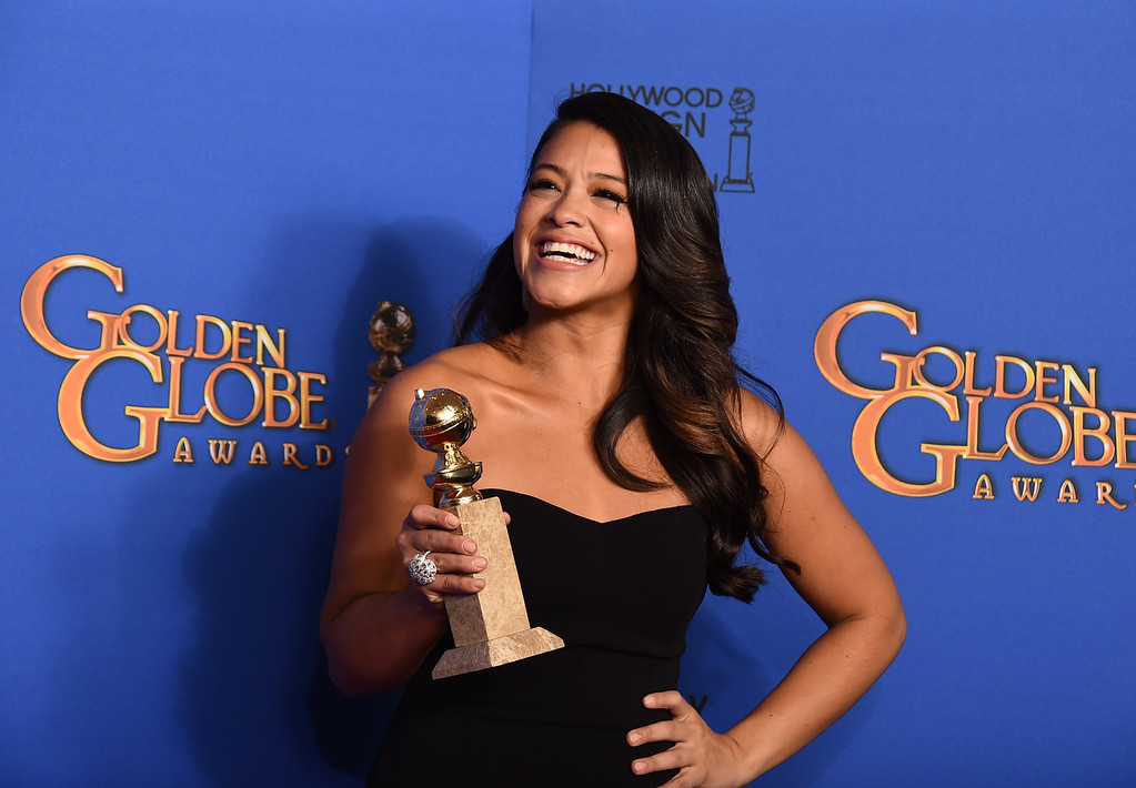 . Gina Rodriguez poses in the press room with the award for best actress in a television series - musical or comedy for ìJane the Virginî at the 72nd annual Golden Globe Awards at the Beverly Hilton Hotel on Sunday, Jan. 11, 2015, in Beverly Hills, Calif. (Photo by Jordan Strauss/Invision/AP)