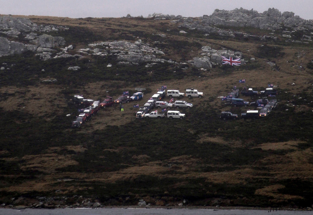 ". A ""Yes\"" sign is formed with cars on a hill in Stanley, March 9, 2013. Voters in the remote British-ruled Falkland Islands hold a referendum on their future on Sunday that seeks to challenge Argentina\'s increasingly vocal sovereignty claim. REUTERS/Marcos Brindicci"