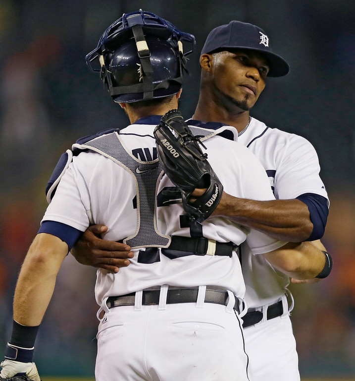 . Detroit Tigers relief pitcher Al Alburquerque hugs catcher Alex Avila after their 7-2 win over the Chicago White Sox in a baseball game, Wednesday, July 30, 2014 in Detroit. (AP Photo/Carlos Osorio)