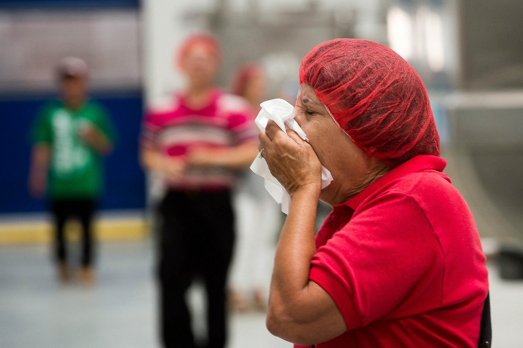 . Munci Gunner, of San Marino, covers her nose as she tours the Sriracha hot sauce factory to see the chili grinding process at Huy Fong Foods in Irwindale on Friday, August 22, 2014. (Photo by Watchara Phomicinda/ Pasadena Star-News)
