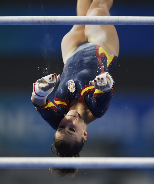 . Spain\'s Roxana Popa Nedelcu performs on the uneven bars during the women\'s qualification at the Gymnastics World Championships in Nanning, in China\'s southern Guangxi province on October 5, 2014. GREG BAKER/AFP/Getty Images