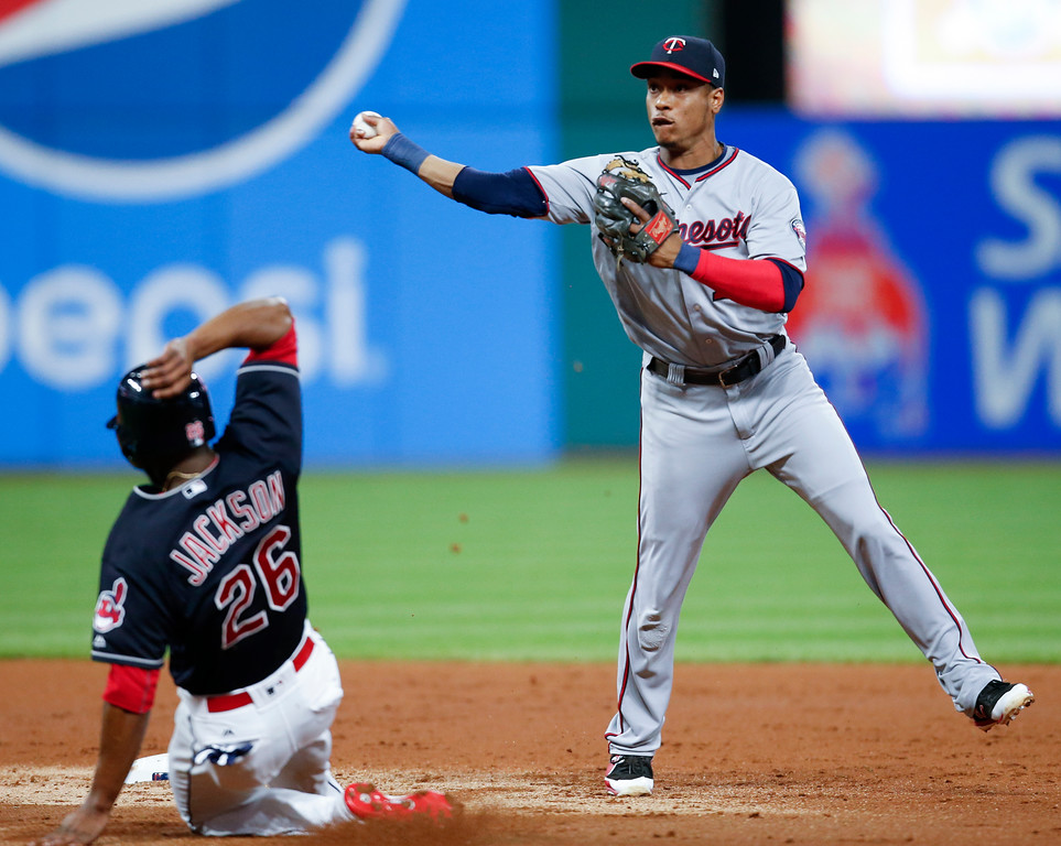 . Minnesota Twins\' Jorge Polanco forces out Cleveland Indians\' Austin Jackson at second base and throws out Jose Ramirez at first base to complete the double play during the third inning in a baseball game, Wednesday, Sept. 27, 2017, in Cleveland. (AP Photo/Ron Schwane)