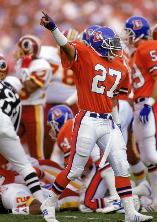 . Defensive back Kevin Clark #27 of the Denver Broncos celebrates as he believes the Broncos have recovered a fumble by Ricky Sanders of the Washington Redskins during a kick off in Super Bowl XXII at the Jack Murphy Stadium on January 31, 1988, in San Diego, California.    (Photo by George Rose/Getty Images)