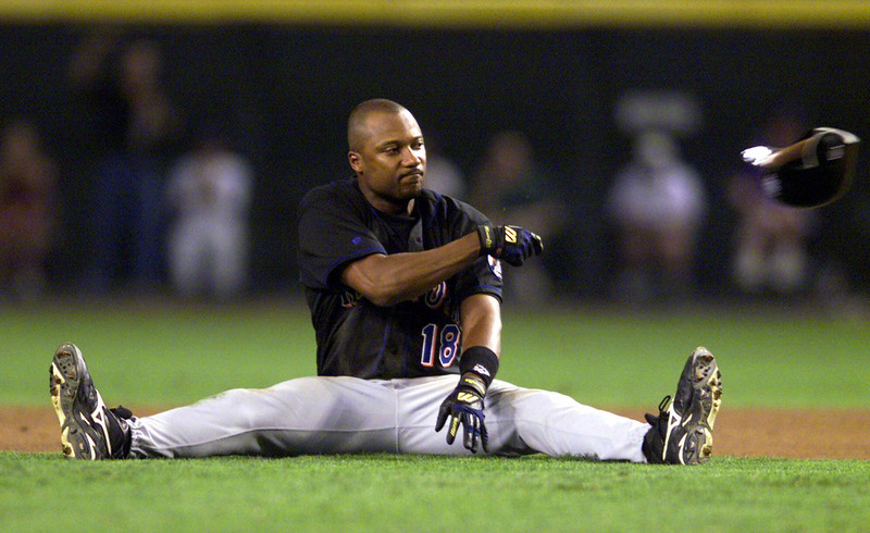 . New York Mets\' Darryl Hamilton throws his helmet after being tagged out on a double play in the fourth inning against the Arizona Diamondbacks during game two of the National League division series playoffs at Bankone Ballpark in Phoenix, Ariz., Wednesday, Oct. 6, 1999. (AP Photo/Eric Draper)