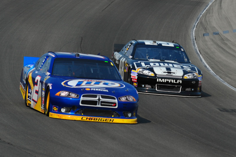 Brad Keselowski (2) and Jimmy Johnson (48) at turn 4 for the Geico 300 Sprint Cup Series at Chicagoland Speedway, Sunday, September 16th, 2012 in Joilet, IL l Gary Middendorf~for Sun-Times Media