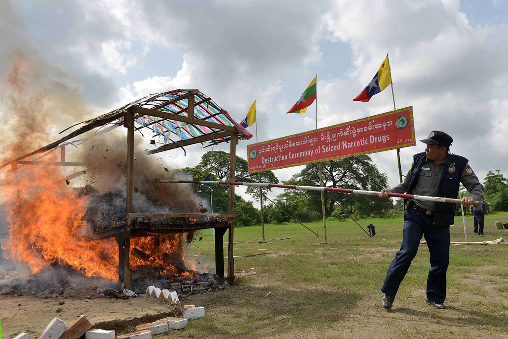 . Seized drugs are set on fire during a destruction ceremony marking the UN\'s international day against drug abuse and illicit trafficking in Yangon on June 26, 2013.  Authorities burned drugs seized across Myanmar, a renowned hub for production, transit and consumption of illicit substances.  Ye Aung Thu/AFP/Getty Images