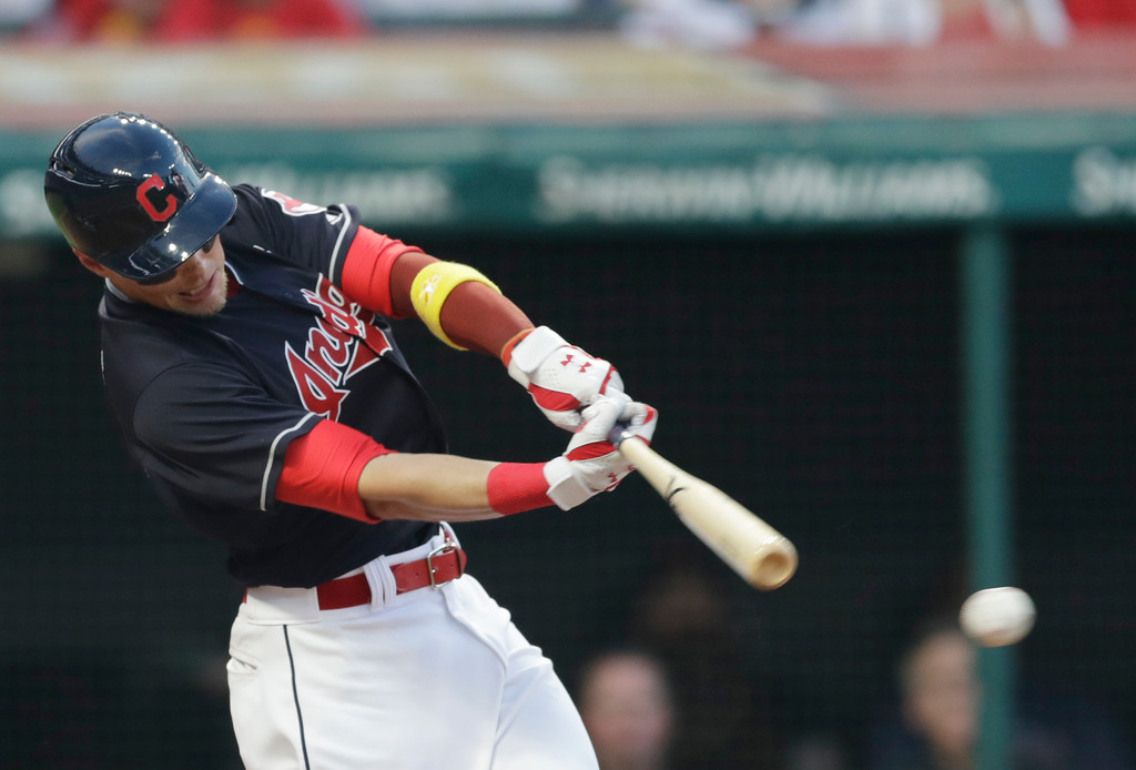 . Cleveland Indians\' Brandon Guyer hits against Tampa Bay Rays starting pitcher Blake Snell in the second inning of a baseball game, Saturday, Sept. 1, 2018, in Cleveland. Guyer was safe at second base on a throwing error by Tampa Bay Rays\' Matt Duffy. (AP Photo/Tony Dejak)