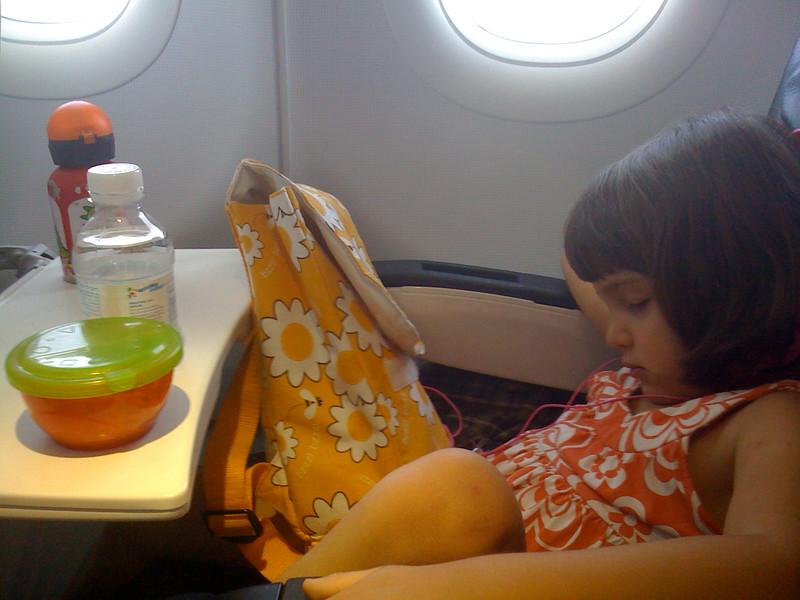 Guen, asleep on the plane.