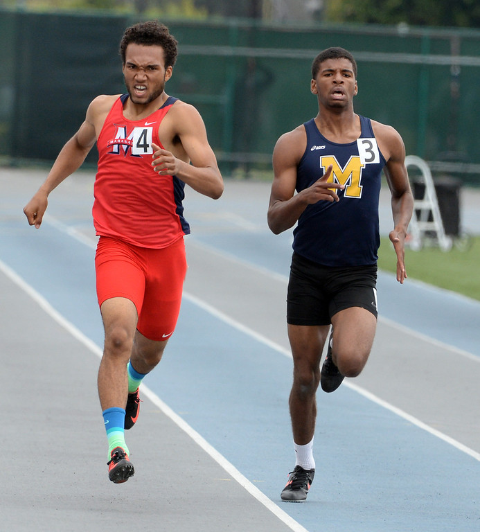 . Maranatha\'s Kyle Brown, left, along with Muir\'s Marcelles Clash competes in the division 4 400 meters race during the CIF Southern Section track and final Championships at Cerritos College in Norwalk, Calif., Saturday, May 24, 2014.   (Keith Birmingham/Pasadena Star-News)