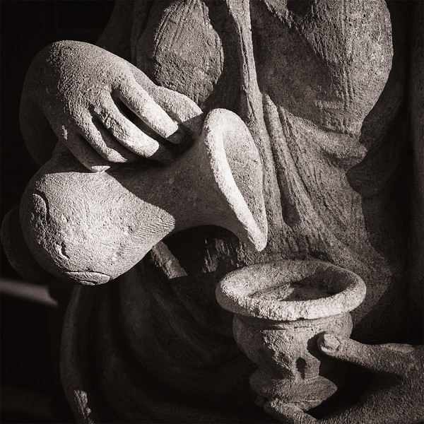 Closeup of a female sculpture with vase and cup in Scottsdale, AZ.