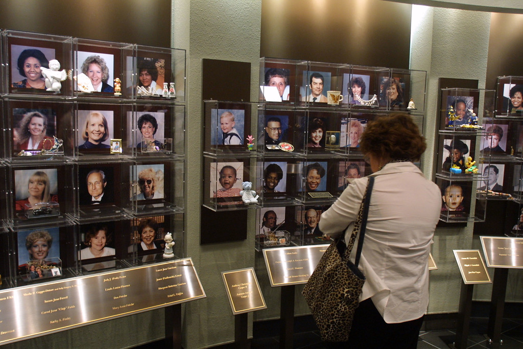 . Visitors look at the faces of the victims of the 1995 Oklahoma City bombing June 11, 2001 at the Oklahoma National Memorial in Oklahoma City, Oklahoma. (Photo by Joe Raedle/Getty Images)