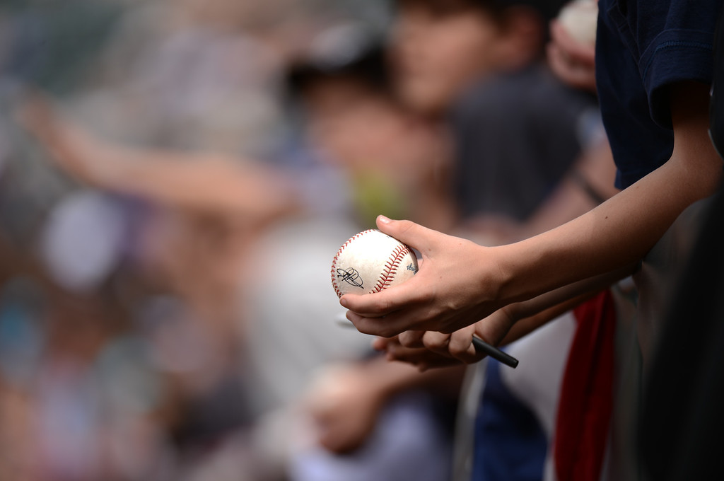 . Fans wait for autograph from Rockies players before the start of the game. (Photo by Hyoung Chang/The Denver Post)