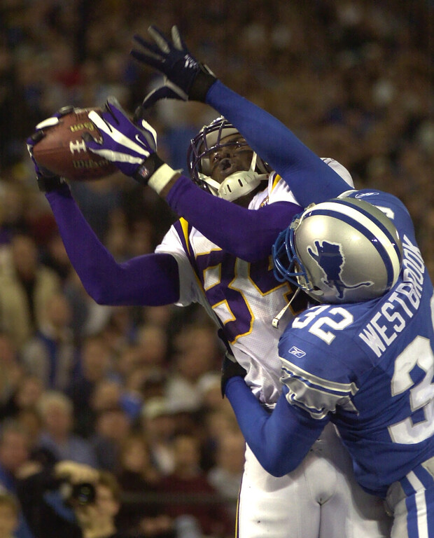 . Minnesota Vikings wide receiver Randy Moss pulls down a 13 yard touchdown pass while Detroit Lions Bryant Westbrook defends in the third quarter putting the Vikings ahead 24-20. The Lions went on to win 27-24 win at the Pontiac Silverdome Sunday December 16, 2001.