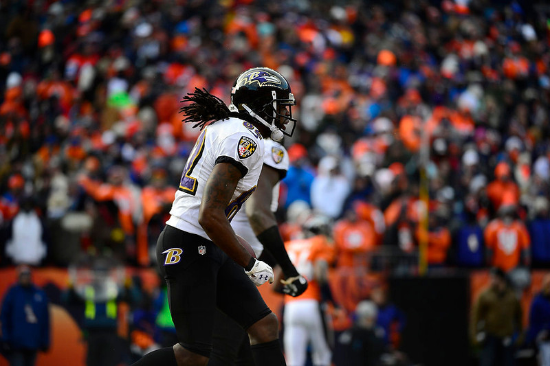 . Baltimore Ravens wide receiver Torrey Smith (82) celebrates a 59-yard touchdown reception in the first quarter. The Denver Broncos vs Baltimore Ravens AFC Divisional playoff game at Sports Authority Field Saturday January 12, 2013. (Photo by AAron  Ontiveroz,/The Denver Post)