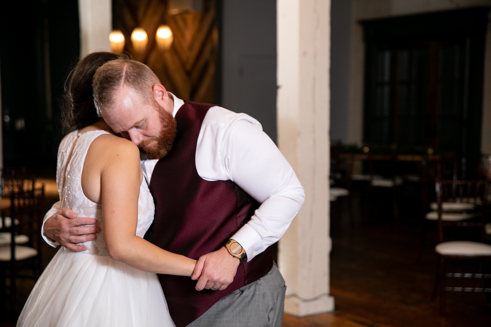 a newlywed couple sharing one last dance as all of their guests have gone