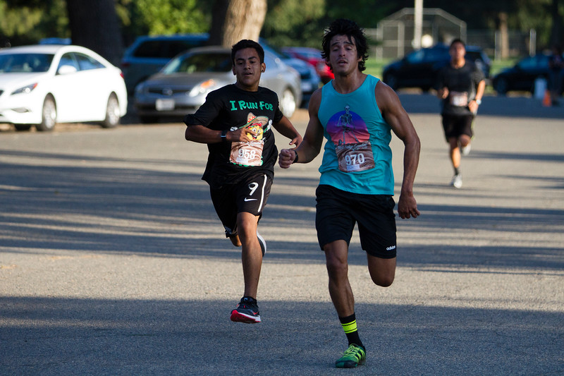 The top two male finishers in Sunday's 2nd Annual Visalia Hot Fudge Sundae Run  race to the finish.  Carlos Cota  (970) was the top  male finisher with a time of  17:56.9.  Allan Suarez (958) finished second in a time of 17:57.3.