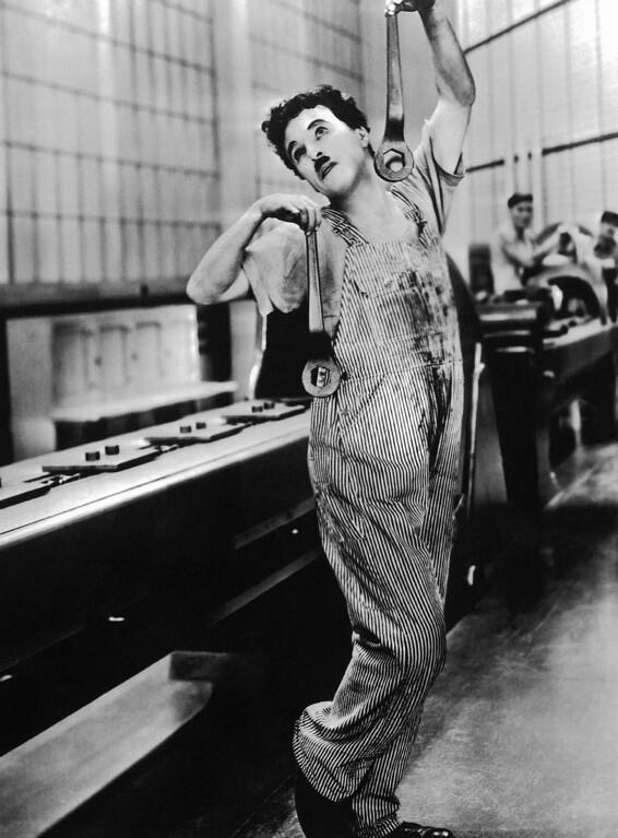 ". Charles Chaplin in film \""Modern Times\"" in 1936. (AP Photo)"