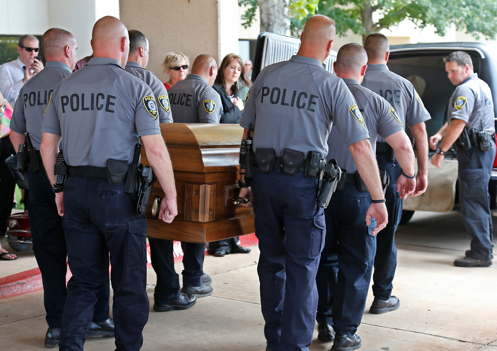 . The casket of Oklahoma City canine officer K-9 Kye, is carried into a waiting hearse following funeral services for the dog in Oklahoma City, Thursday, Aug. 28, 2014.  (AP Photo/Sue Ogrocki)