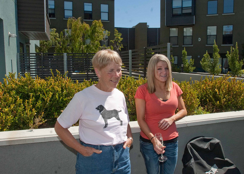Janet and Kristen supervise the grilling.