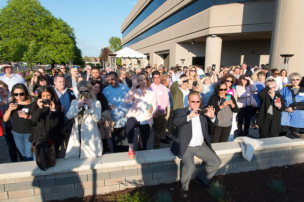 05/15/19 Wesley Bunnell | Staff The Greater New Britain Chamber of Commerce @ Tomasso Group held an after business party with food and drinks and networking before unveiling their signature bee which is part of Bees Across New Britain. A large crowd waits for the bee to be unveiled.