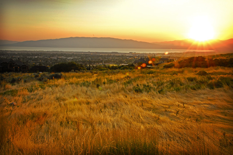 2011/9/7 – I drove up on the foot hills above my home to see if there was a picture for today. I shot several different images, but this was my favorite, looking out over the valley with the golden grasses in the foreground and the sun setting behind the mountains across Utah Lake.
