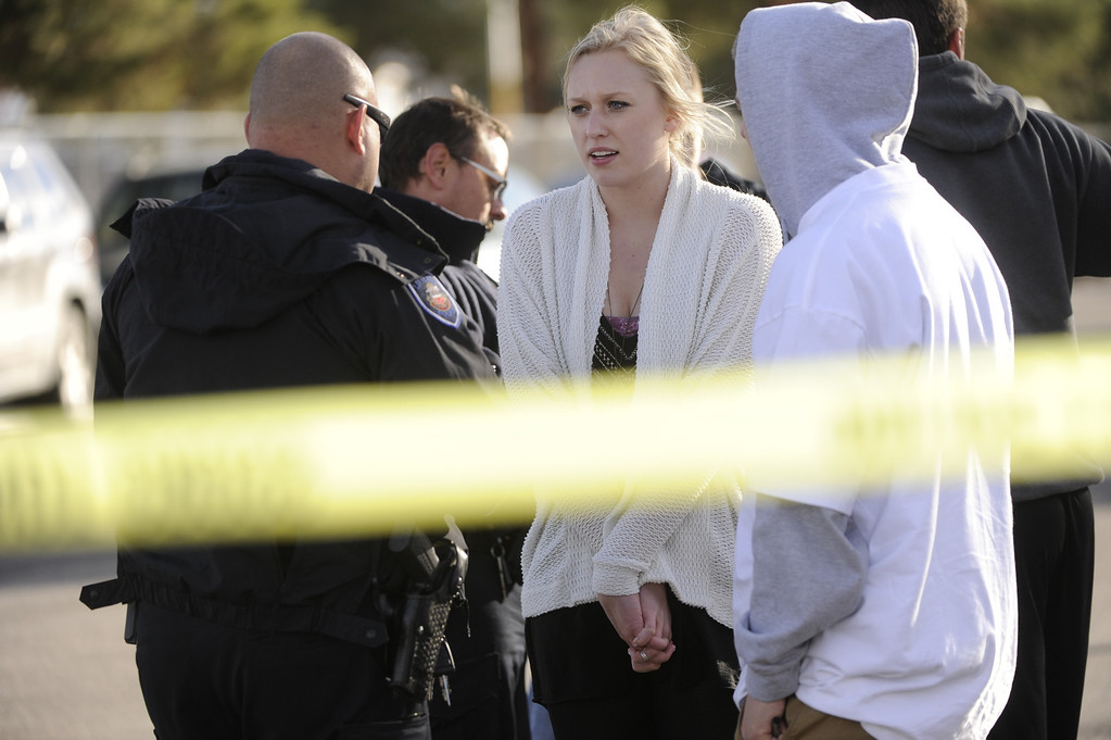 . CENTENNIAL, CO. - DECEMBER 13: Arapahoe High School students told police what they had seen inside Arapahoe High School Friday afternoon, December 13, 2013. A shooting inside the school sent hundreds of students rushing for safety. Photo By Karl Gehring/The Denver Post