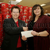 Cathy Morrison Development manager Young Enterprise NI recieves a donation from Majella Farmer, Dunnes stores Newry for the upcoming Young Enterprise NI annual Entrepreneurial Masterclass on the 29th November. 06W48N32
