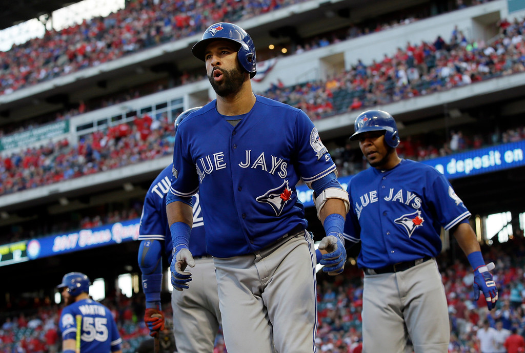 . Toronto Blue Jays\' Jose Bautista and Edwin Encarnacion, right, head to the dugout after Bautista\'s three-run home run against the Texas Rangers during the ninth inning of Game 1 of baseball\'s American League Division Series, Thursday, Oct. 6, 2016, in Arlington, Texas. The Blue Jays won 10-1. (AP Photo/LM Otero)