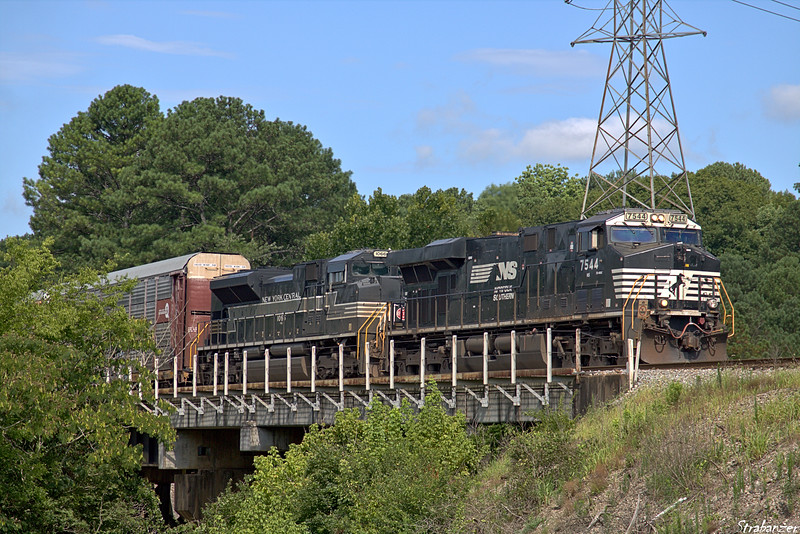 """Tennessee Valley Railroad Museum Norfolk Southern GE ES44DC 7544 leads EMD SD70ACe1066 on the main line past the museum.    1066 is one of the 20 NS locos  painted in the colors of New York Central as part of NS's """"Heritage"""""""" program for its 30th anniversary in 2012. Chattanooga, TN, 07/13/2019 This work is licensed under a Creative Commons Attribution- NonCommercial 4.0 International License"""