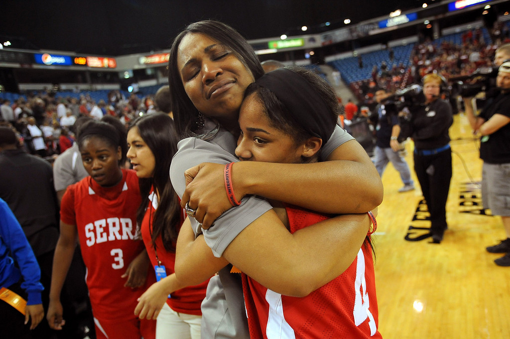 . Serra High School assistant coach Shanika Russell embraces Deandrea Toler after defeating Salesian High during the Division IV 2013 CIF State Basketball Championships at Sleep Train Arena, in Sacramento, Ca March 23, 2013.(Andy Holzman/Los Angeles Daily News)
