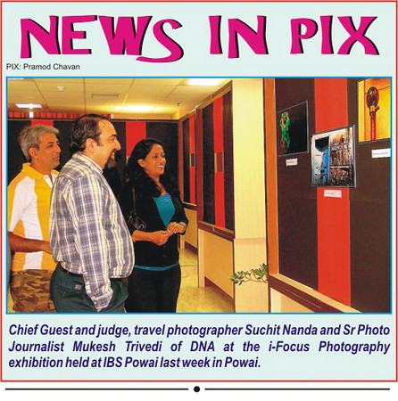Mukesh Trivedi and Suchit Nanda judging the photos at i-Focus Photography competition & exhibition held at IBS, Hiranandani Gardens, Powai. January, 2011. Also seen in the picture is Anu (Arundhathi). Photo Credit: Pramod Chavan as printed in Powai Planet.