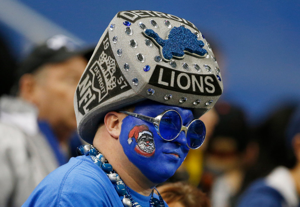 Description of . A Detroit Lions fan waits for an NFL football game between the Detroit Lions and the Atlanta Falcons at Ford Field in Detroit, Saturday, Dec. 22, 2012. (AP Photo/Carlos Osorio)