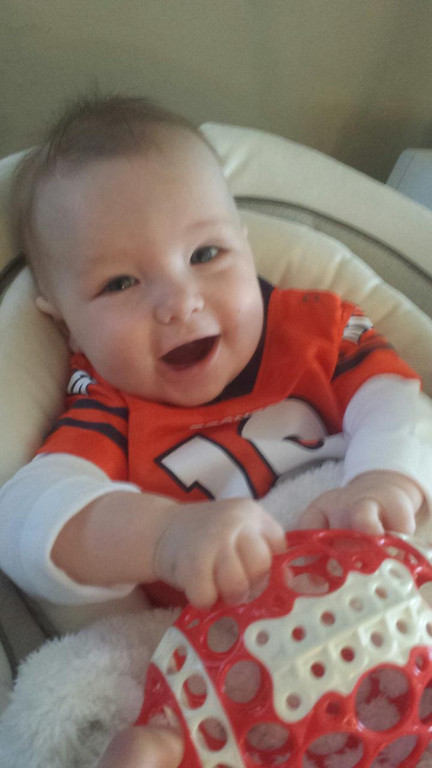 . Our 6 month old cheering on the Broncos against Brady and company!