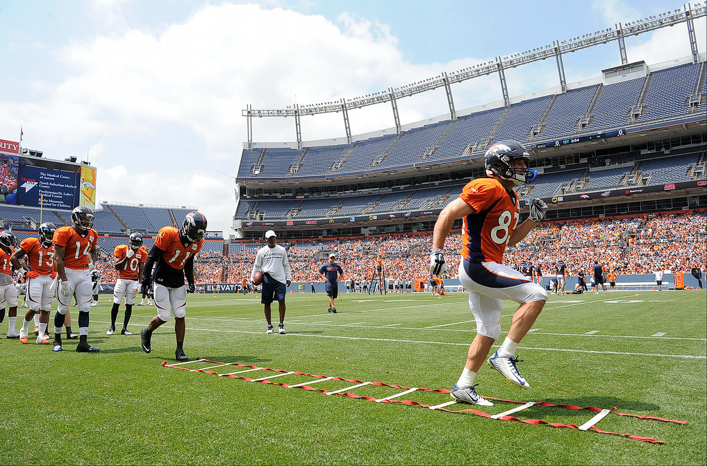 . Denver Broncos wide receiver Wes Welker (83) runs through drills on day four of the Denver Broncos 2014 training camp July 27, 2014 at Sports Authority Field at Mile High. (Photo by John Leyba/The Denver Post)