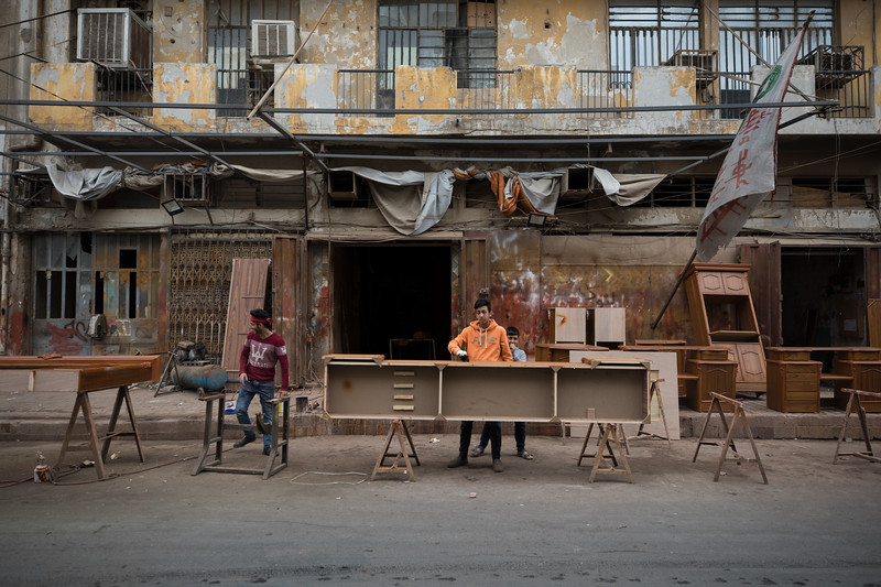 Cabinetmakers varnishing their handywork in Baghdad.