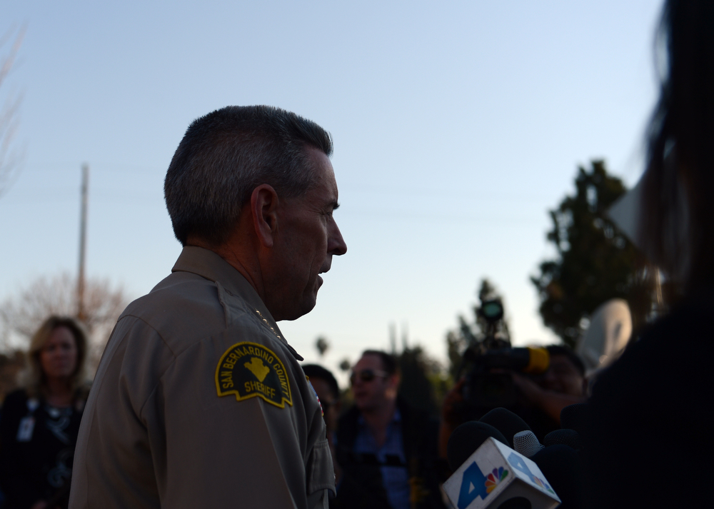. (Thomas R. Cordova/Staff Photographer) San Bernardino County Sheriff John McMahon walks out of the ER at Loma Linda University Medical Center to report to the media that one police officer was killed and one injured by Christopher Dorner in the Big Bear area in Loma Linda February 12, 2013.