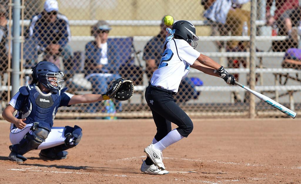 . 0314_SPT_TDB_L_CAR-NORTH--- Torrance, CALIFORNIA--3/13/13--- Staff Photo: Robert Casillas / LANG--- Carson at North Torrance softball. Danika Justis takes a swing.