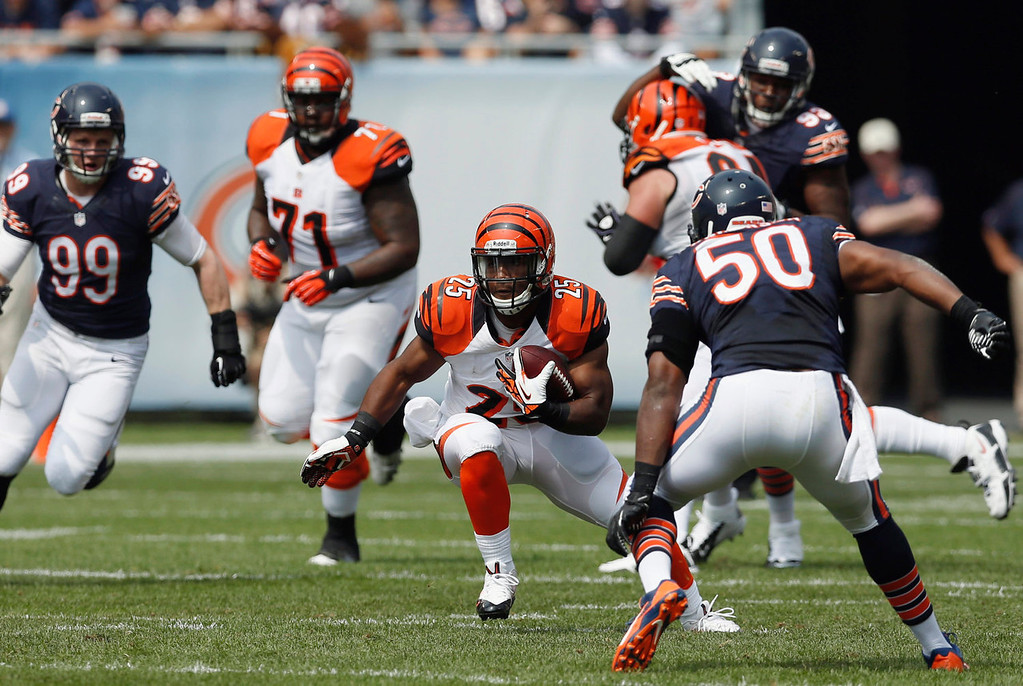 . Cincinnati Bengals running back Giovani Bernard (25) rushes against Chicago Bears linebacker James Anderson (50) during the first half of an NFL football game, Sunday, Sept. 8, 2013, in Chicago. (AP Photo/Charles Rex Arbogast)