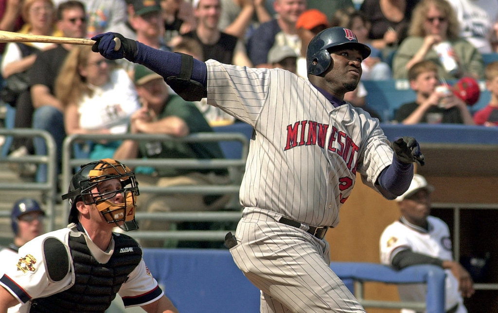 . Minnesota\'s David Ortiz follows through on his two run go ahead home run in the eighth inning against the White Sox at U.S. Cellular Field in Chicago on April 22, 2001.  (AP Photo/Stephen J. Carrera)
