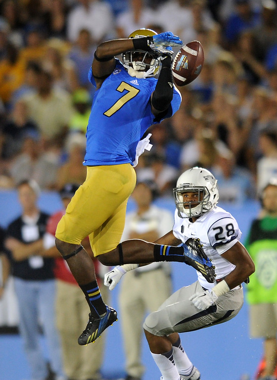 . UCLA WR Devin Fuller can\'t haul in a pass in the fourth quarter as Nevada\'s Elijah Mitchell defends, Saturday, August 31, 2013, at the Rose Bowl. (Michael Owen Baker/L.A. Daily News)
