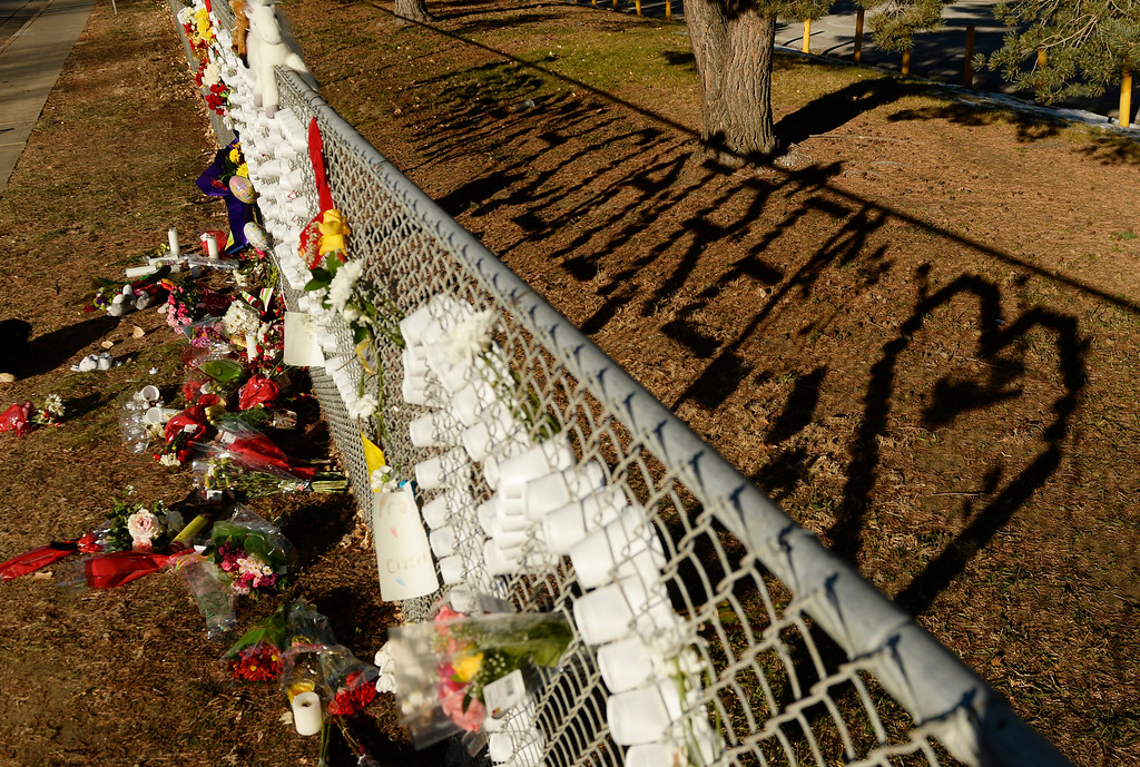 . A sign of support for shooting victim Claire Davis is woven into a fence around Arapahoe High School in Centennial, December 16, 2013. The school was the scene of a shooting on Friday that left a student gunman dead and two other students injured. (Photo by RJ Sangosti/The Denver Post)
