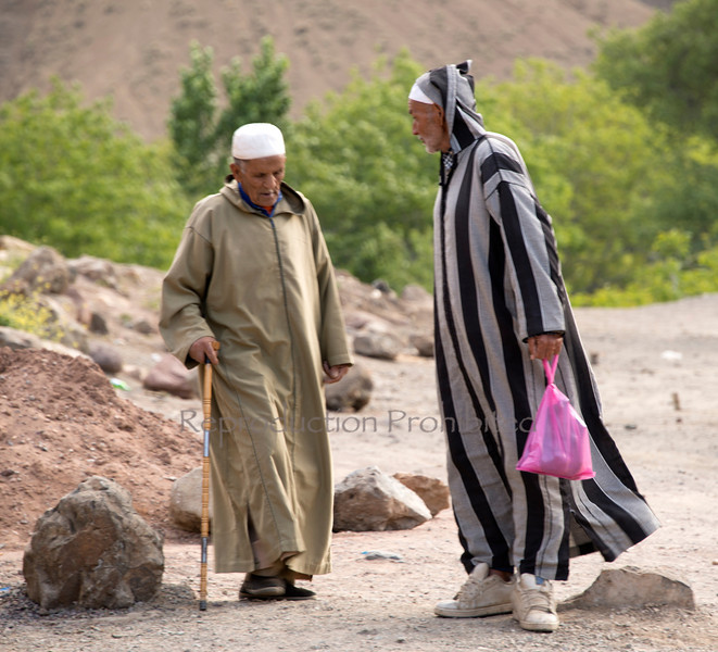 Two Men Along the road to Marrakech from Ouarzazate Morocco April 2013
