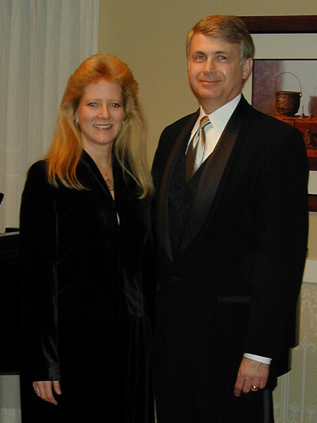 Pamela & Howard (in a tuxedo!) at the 25th Anniversary celebration of Williams, Young & Associates in 2000.