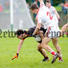 Philip Magowan Photography - Northern Ireland - 19 March 2017<br /> <br /> Pictured: Jamie Clarke is up-ended by Louth's Padraig Rath.<br /> <br /> Picture: Philip Magowan
