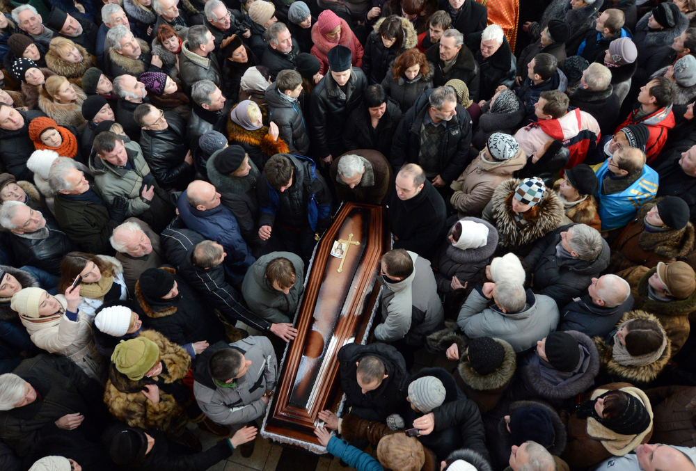 . Some 100,000 Ukrainians take part in the funeral ceremony of dead protester Yuri Verbytsky in the western city of Lviv on January 24, 2014. Verbytsky, was reportedly abducted on Tuesday and was found dead in a forest near Kiev Thursday. (YURIY DYACHYSHYN/AFP/Getty Images)