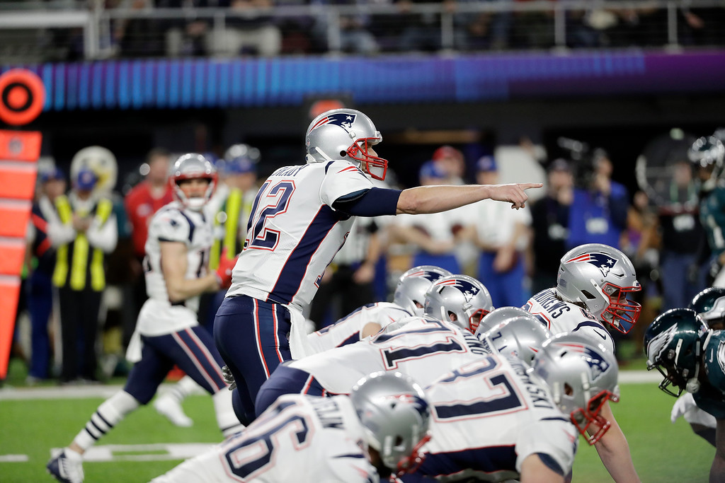 . New England Patriots\' Tom Brady signals during the first half of the NFL Super Bowl 52 football game against the Philadelphia Eagles Sunday, Feb. 4, 2018, in Minneapolis. (AP Photo/Mark Humphrey)